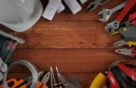 Construction equipments on wood background with copy space