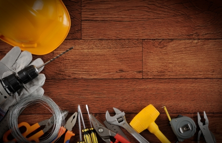 Construction equipments on wood background with copy space  Stock Photo - 14371453