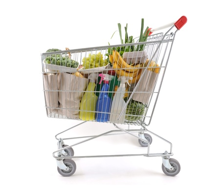 Shopping cart full of groceries from side