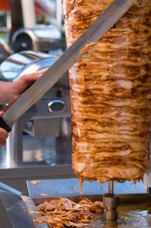 chicken kebab: Chef slicing Turkish kebab     Stock Photo