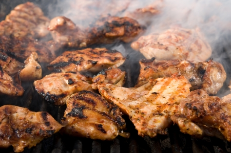 Grilled chicken breasts on barbecue smoking  Stock Photo
