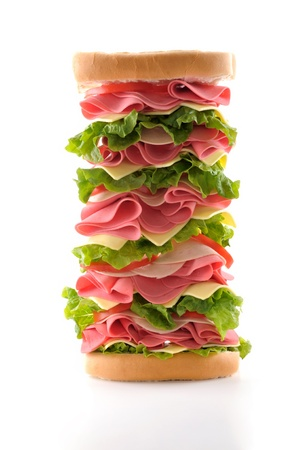 Deli: Healthy and big ham sandwich with lettuce, tomato and cheese isolated on white background.