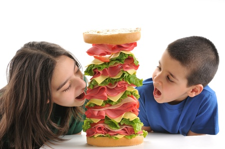 schooler: Little child and teen girl with sandwich isolated on white background Stock Photo