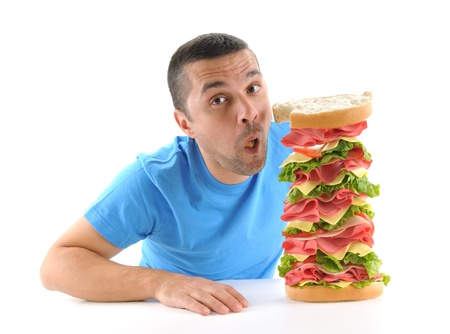Adult man eating a big sandwich over white background
