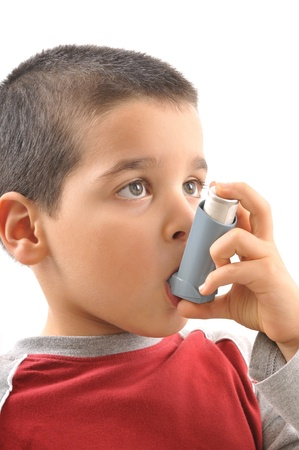 Cute boy with respiratory problem or asthma     photo
