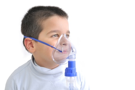 Cute boy with astma using oxygen mask