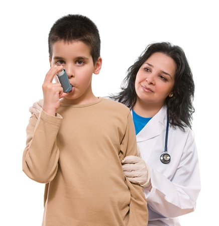 Medical doctor applying oxygen treatment on a little boy with asthma photo