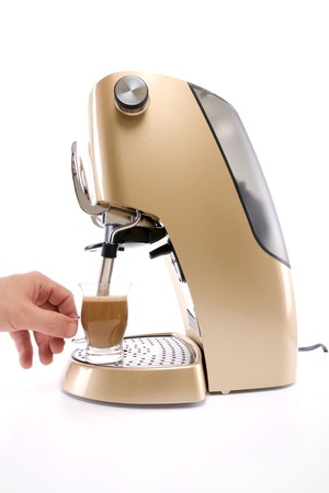 Making Cappuccino using Coffee Maker machine