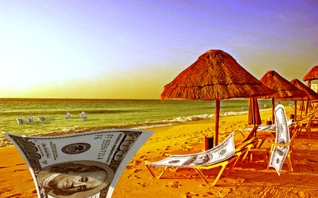 sunbathe: Dollars resting on the beach. They sunbathe, swim in the sea, posing for the camera. Stock Photo