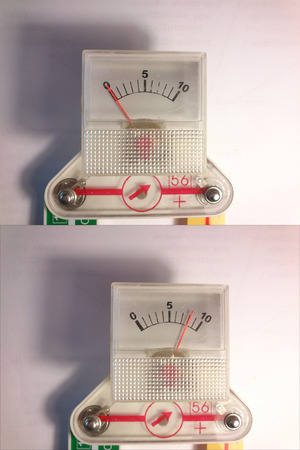ammeter: The measuring device, which is used as a voltmeter and ammeter. He photographed on a light background. He is, at its heart, it looks like a toy (a total of ten points). Scope of application of the image is the initial training of technical specialties and