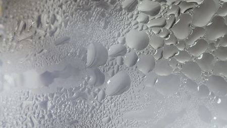 Condensate steam from boiling water on misted glass