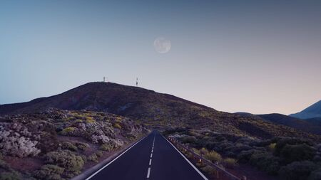 road at dusk among the frozen volcanic lava of the volcano Teide Tenerife