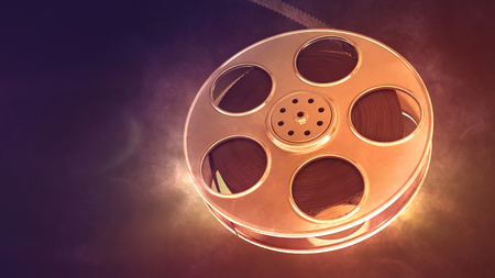 Retro film reel on burn background. Closeup with area for a text. 3d illustration