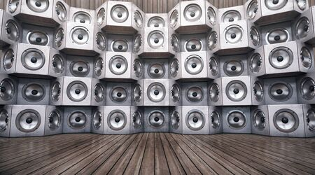 Wall of musical speakers on a wooden background