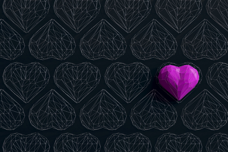 Unique fuchsia heart on black background among the many empty wireframe hearts. Abstract polygonal heart with shadow. Love symbol. Low-poly colorful style. Romantic background for Valentine day. 3d rendering