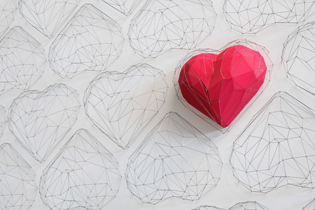 Unique Red heart on white background among the many empty wireframe hearts. Abstract polygonal heart with shadow. Love symbol. Low-poly colorful style. Romantic background for Valentine day. 3d rendering