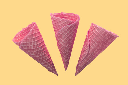 Sweet ice cream cones isolated on yellow background. 3d illustration