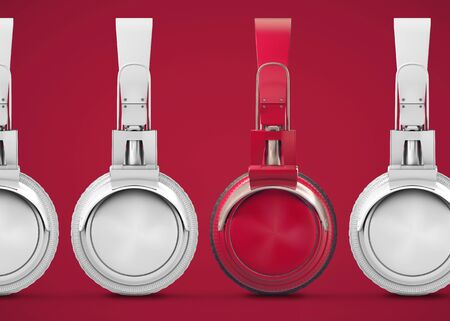 Unique red headphones among many others. Standing out from the crowd, individuality and the concept of difference. 