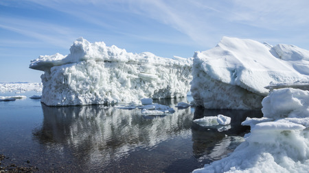 he coast of the Sea of Okhotsk in the spring with floating ice floes
