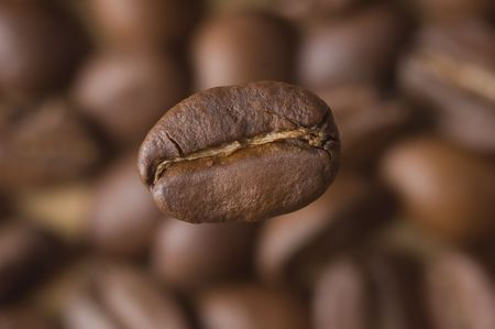 caffiene: Coffee Bean close-up and Beans as background Stock Photo