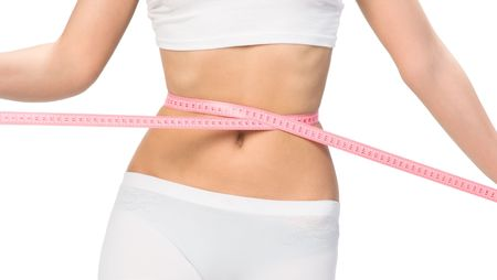 toning: Woman showing how much weight she lost Stock Photo