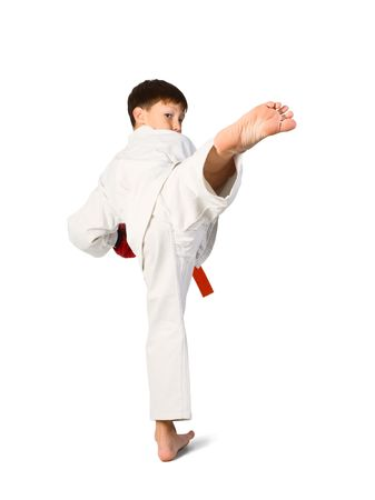 A young boy aikido fighter in white kimono photo