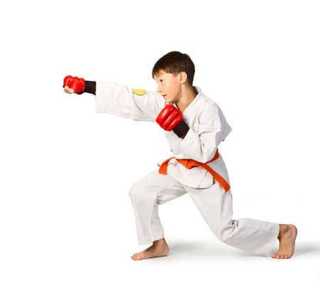 A young boy aikido fighter in white kimono photo