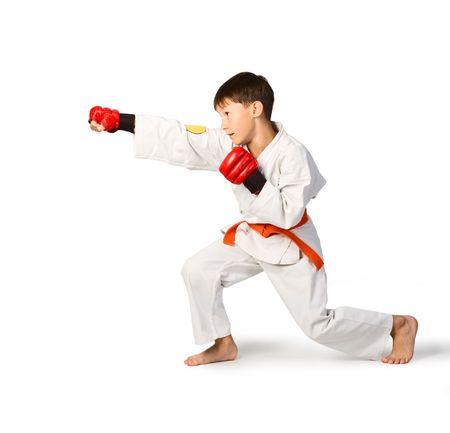 jujitsu: A young boy aikido fighter in white kimono