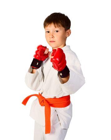 arts: A young boy aikido fighter in white kimono