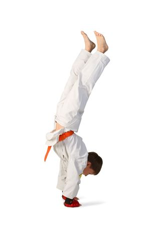 karate boy: A young boy aikido fighter in white kimono  aikido boy Stock Photo