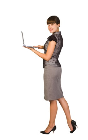 Beautiful businesswoman with laptop.Isolated on white background photo