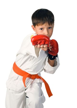 A young boy aikido fighter in white kimono Stock Photo