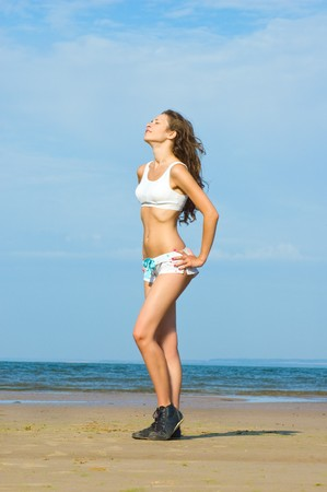 Young beautiful woman is relaxing on the beach photo