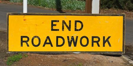 roadwork: end roadwork traffic sign standing on the ground