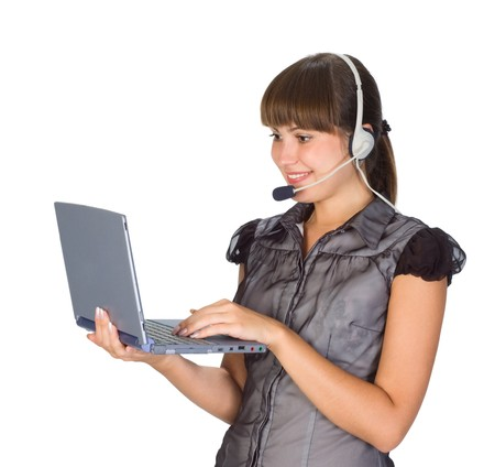 beautiful girl in headset with laptop photo
