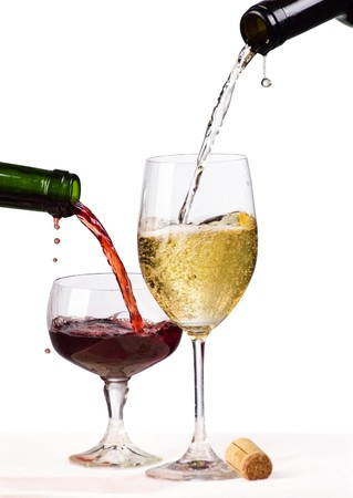 white and red wine being poured into a wine glass Stock Photo