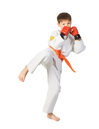 aikido: A young boy aikido fighter in white kimono showing Martial Art