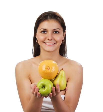 pretty young  girl with fruit in her hands on white background photo