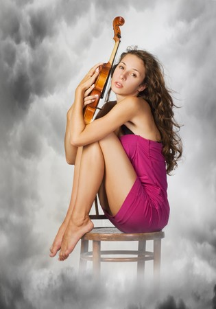 woman and violin pretty young woman  holding viola in her hands photo
