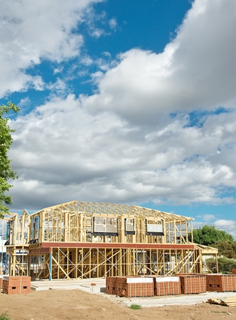New residential construction home framing against a blue sky. Stock Photo - 8374178