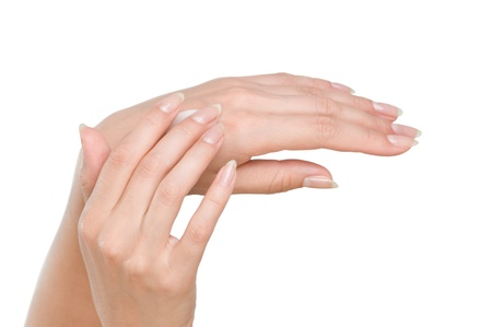 Two woman hands with moisturizer body cream isolated on white Stock Photo - 8485564