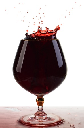 A glass of Wine with splash on white background photo