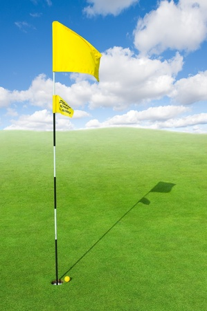 landscape of a green golf field with sky photo