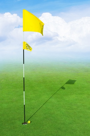 landscape of a green golf field with clouds and haze  photo