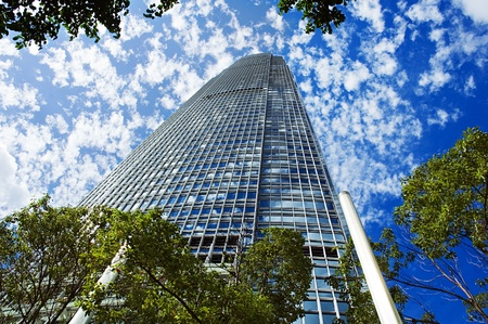Modern building Skyscraper on the sunny beautiful sky Stock Photo - 9169125