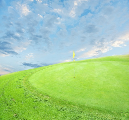 landscape of a green golf course with sky.Shallow focus photo