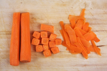 Chopped carrot for cooking on the rustic wooden board Stock Photo - 9317082