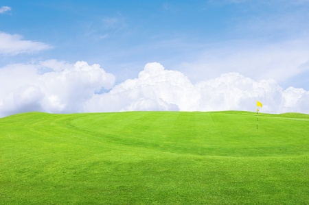 Landscape of a green golf course with sky.Shallow focus.  photo