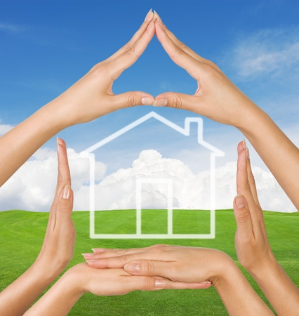 Female hands showing conceptual home symbol over summer landscape  background Stock Photo - 9392072