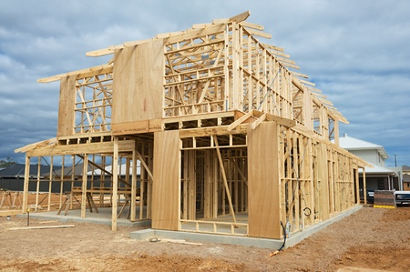 New residential construction home framing against a blue sky photo